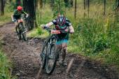Two mountainbiker in a uphill race — Stock Photo