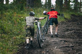 Two mountainbiker in the forest — Stock Photo