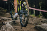 Young athlete mountain bike uphill the stones — Stock Photo