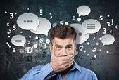 Knappe zakenman sluiten zijn mond met palmen — Stockfoto