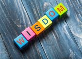 Wisdom. Concept of wisdom word on colorful wooden cubes — Stock Photo