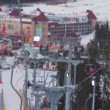 Skiers ascend on the ski lift up to the mountain — Stock Video #69537925