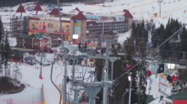 Skiers ascend on the ski lift up to the mountain — Stock Video