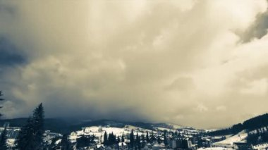 Clouds moving over the top of the mountain. Timelapse — Wideo stockowe