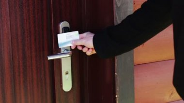 The man opens the door to an electronic key - card. — Stock Video