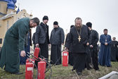 Firefighters and priests — Stock Photo