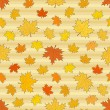 Seamless autumnal pattern with maple leaves — Stock Vector #80304998