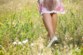 Female legs in grass — Stock Photo
