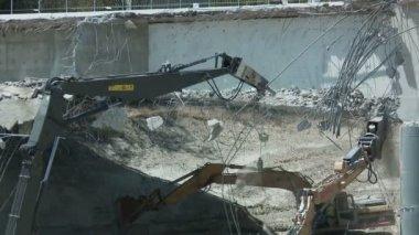 Heavy equipment crushes bridge — Stock Video