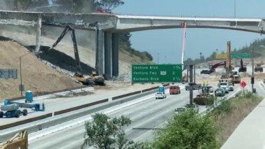 Heavy equipment tearing downbridge — Stock Video