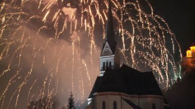 Fireworks display behind a church — Stock Video