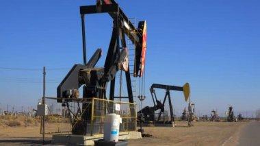 Oil derricks pump crude — Stock Video