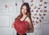 Beautiful woman holding osier heart — Stock Photo