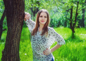 Young woman in the garden — Stock Photo