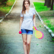 Young woman with toy badminton — Stock Photo #78320982