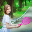 Young woman with toy badminton — Stock Photo #78320986