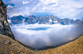 High up in the mountains above the clouds — Stock Photo