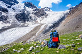 Big backpack on a background of mountains — Stock Photo