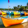 Bright fishing boats on the river bank — Stock Photo #68056981