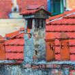 Architecture details of the house with old chimneys and tile roo — Stock Photo #70556653