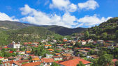 Panoramic view of mountain village with church — Stock Photo