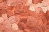 Wall made of stones. Red color. — Stock Photo