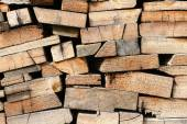 Cross sections of different logs   (Stack of old sawed boards) — Stock Photo