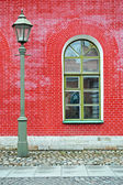 Lantern and red wall — Stock Photo