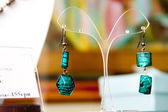Handmade jewelry and keychains with colorful glass beads — Stock Photo