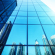 Reflection of  skyscrapers on a glass building — Stock Photo #69982441