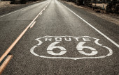 Route 66 sign on the road — Stock Photo