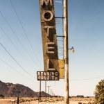 Motel sign in desert — Stock Photo #69992899