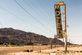 Motel sign in desert — Stock Photo