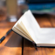 Open notebook with pencil on wooden table — Stock Photo #70170073