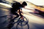 Blurred silhouette of a cyclist — Stock Photo