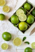 Limes on a white background — Stock Photo