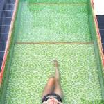 Asian girl lying in the swimming pool — Stock Photo #69636481