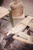 Proceedings ancient craft artisan to straw chairs — Stock Photo