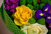 Beautiful bouquet of bright flowers in basket — Stock Photo