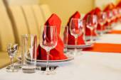 Red and white table set with empty glasses in restaurant — Stock Photo