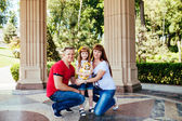 A young family, a pregnant mother, father, daughter — Stock Photo
