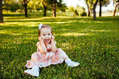 Cute little girl on the meadow in summer day. — Stock Photo