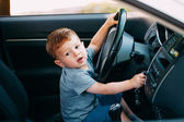 Cute little boy driving fathers car — Stock Photo