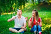 Couple Relaxing in the Park with bubble blower. Spring time — Stock Photo
