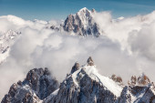 Snowy mountains in clouds — Stock Photo