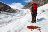 Climber in the Polar Desert, Nigardsbreen glacier, Norway — Stock Photo