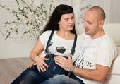 Pregnant woman with her loving husband in a happy anticipation o — Stock Photo
