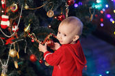 Little girl waiting for a miracle in Christmas decorations — Foto Stock