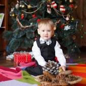 Little boy in Christmas decorations expect a miracle — Stockfoto