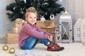 Little girl waiting for a miracle in Christmas decorations — Foto de Stock